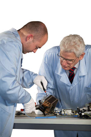 IT - engineers doing repairs on a fan photo