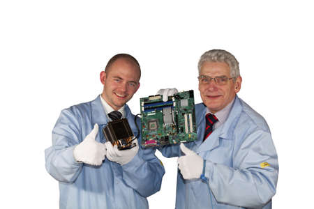 Successful IT - engineers presenting a motherboard, a fan and posing with the thumbs up sign Standard-Bild