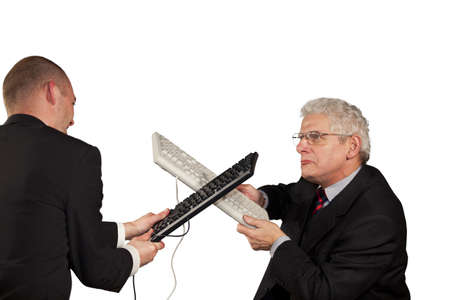 freak out: Two angry businessmen hitting each other with keyboards Stock Photo