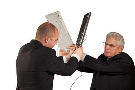 Two angry businessmen hitting each other with keyboards photo