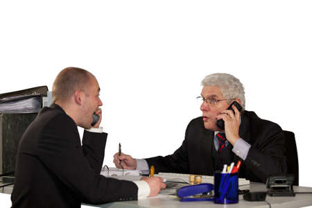 Two businessmen having a tough discussion during a telephone conference photo