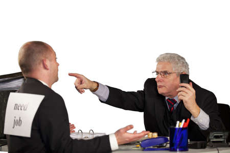 A senior manager rejecting a job applicant and kicking him out of the office Standard-Bild