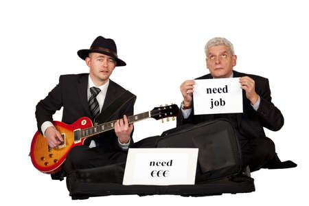 solicit: Two unemployed men in business dresses playing guitar and begging for money and a job