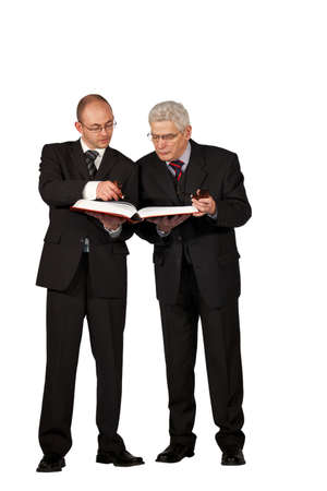 Two businessmen with pipes reading a book photo