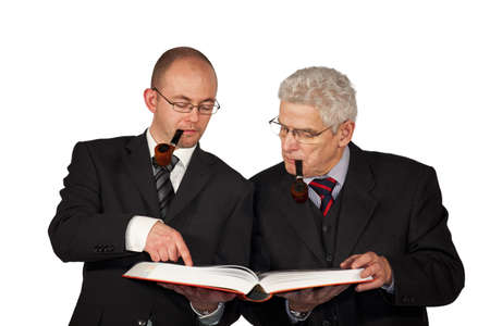 recognizing: Two businessmen with pipes reading a book Stock Photo