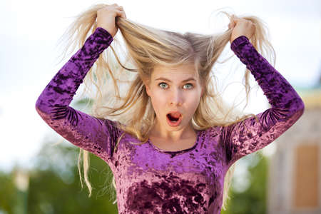 freak out: A shocked beautiful blond fashion model tearing her hair