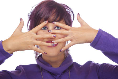 A smiling beautiful fashion model showing her acrylic fingernails, shot on white studio background photo