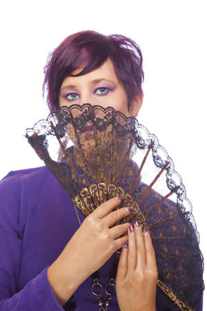 A beautiful fashion model with acrylic fingernails holding a fan, shot on white studio background photo