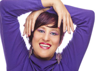 A laughing beautiful fashion model showing her acrylic fingernails, shot on white studio background Stock Photo - 12136374