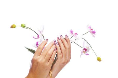 Ein Beauty-Konzept - die Hände mit Acryl Fingernägel mit Blumen, auf weißem Hintergrund Studio erschossen Lizenzfreie Bilder