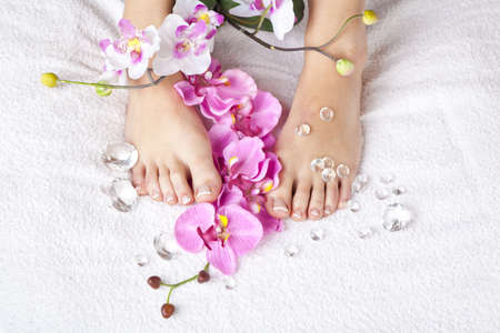 french model: A beauty concept - feet with acrylic toenails, flowers and crystals