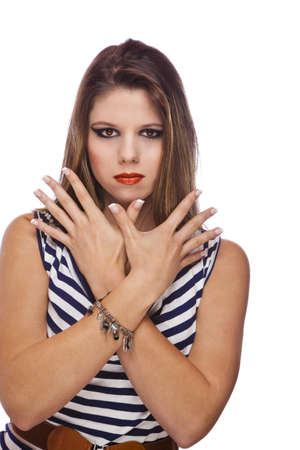 A cool looking beautiful teenage fashion model showing her acrylic fingernails, shot on white studio background photo