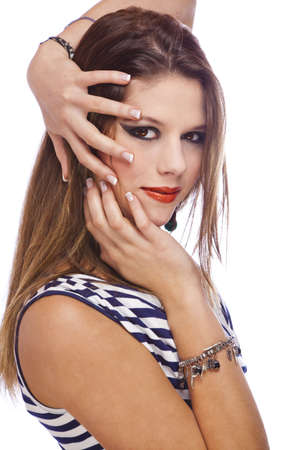 A smiling beautiful teenage fashion model showing her acrylic fingernails, shot on white studio background photo