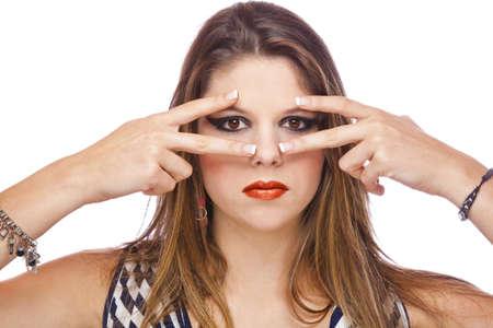 A cool looking beautiful teenage fashion model showing her acrylic fingernails, shot on white studio background photo