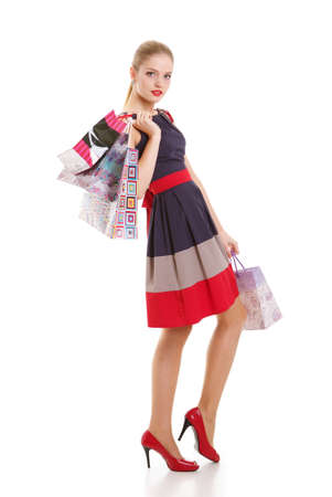 Portrait of young happy smiling woman with shopping bags photo
