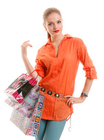 girl in orange shirt with shopping bags photo