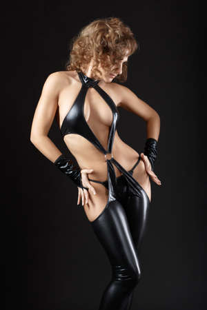 Dancing model dressed in clothes from latex. BDSM. Fetish. photo