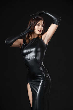 Dancing model dressed in clothes from latex. BDSM. Fetish. Stock Photo