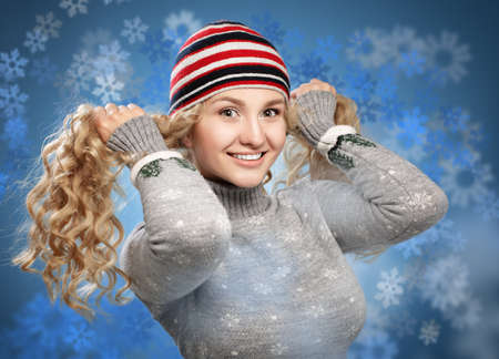 Happy girl with golden curls hair playing with snowy background. Studio photography. Winter concept. photo