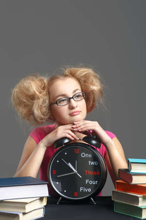 Dreaming student lies on the big clock. photo