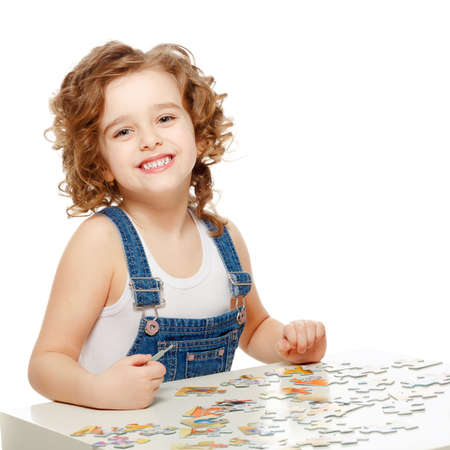 Little baby playing in the puzzle photo