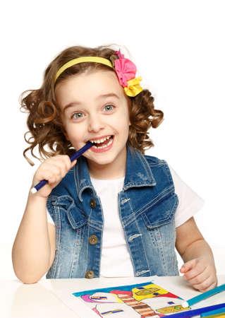 Happy child draws felt-tip pen. White background. Isolated. photo