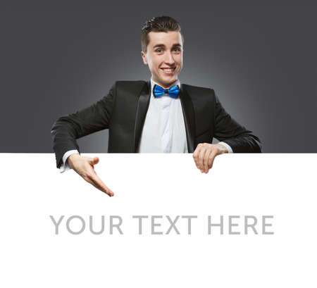 Young man holding a whiteboard  Concept - a demonstration of achievements in business, graphic ads  photo