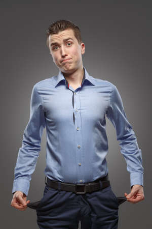 with no money: Young man with pockets turned inside out  Concept - no money, crisis, problems Stock Photo