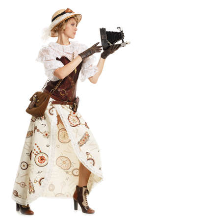 Beautiful woman with retro camera. Steampunk. Isolated on white. Copyspace for text. photo