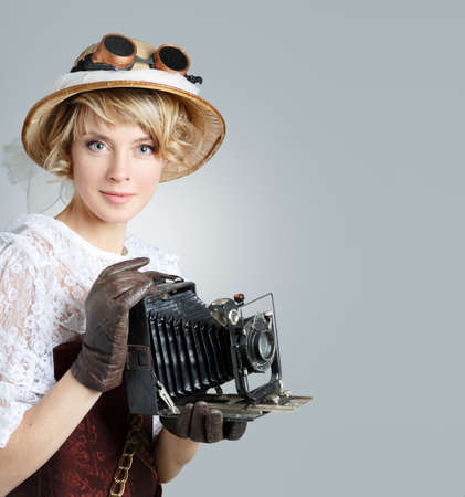 Beautiful happy woman with retro camera. Copyspace for your text. photo