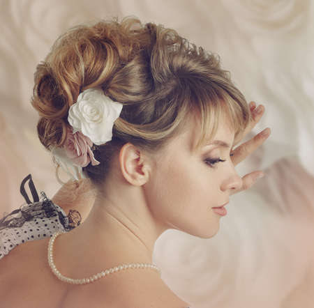 updo: Beautiful bride with a wreath of roses. Updo. Wedding makeup.