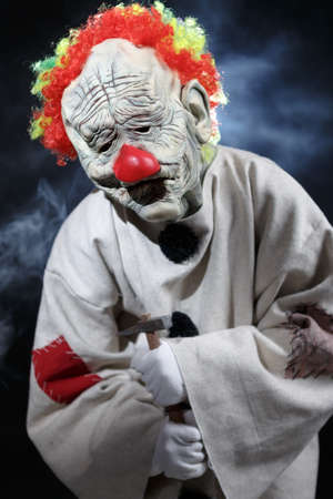 monster movie: Scary monster clown with hammer