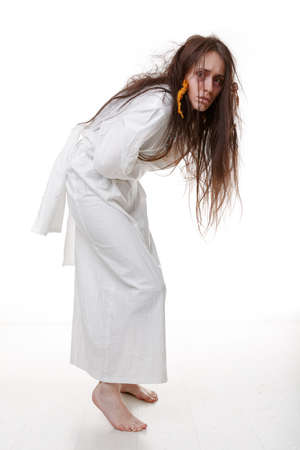 Portrait of a crazy woman in a straitjacket. photo