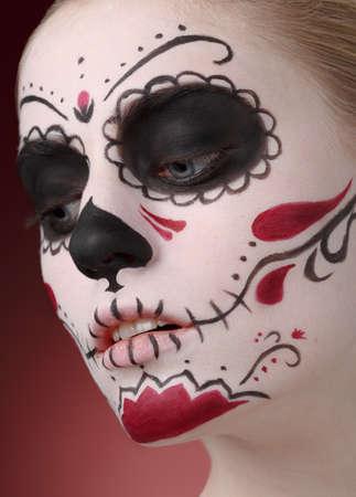 Woman with dia de los muertos makeup