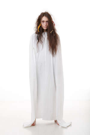 Portrait of a crazy woman in a straitjacket in white room photo