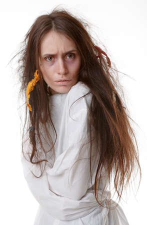 Portrait of a crazy woman in a straitjacket. Isolated on white. photo