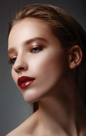 High fashion look. Glamor closeup portrait of beautiful sexy stylish caucasian young woman model with bright makeup, with red lips, with perfect clean skin Stock Photo