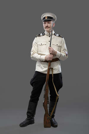 trooper: Civil War in Russia, Russian Civil War 1918-1922, White Guard, Trooper of 1st General Markov (Markoff) Officers Regiment. Isolated on grey background.