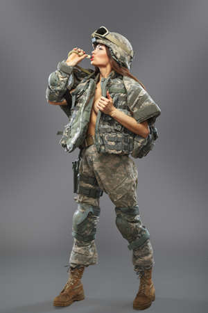 """belonging to the caucasoid race: Sexy girl in the form of a soldier of the American division. Operation """"Desert Storm Stock Photo"""