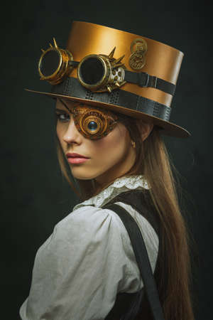 Close-up portrait of a beautiful girl steampunk, hat and eyecup Stock Photo