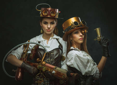 steampunk: Two girls dressed in the style of steampunk with arms.