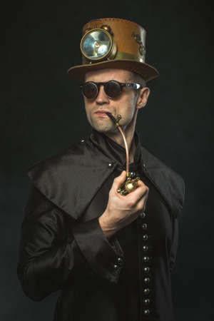 Steampunk man in a hat smoking a pipe