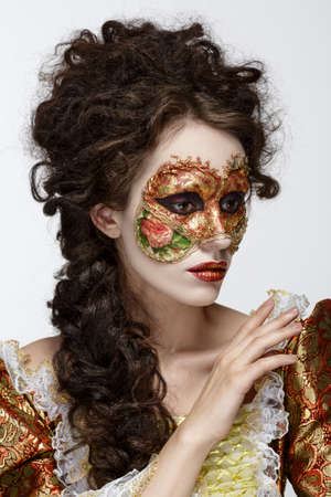 faceart: Faceart. Venetian mask. Beautiful woman in vintage dress and a mask on his face.