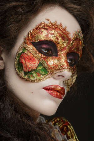 faceart: Faceart. Venetian mask. Close-up portrait of Beautiful woman in vintage dress and a mask on his face.