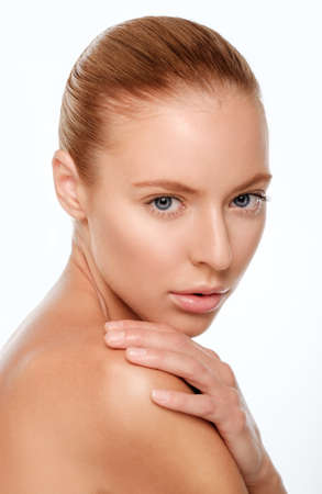 Beauty Girl. Portrait of Beautiful Young Woman. Fresh Clean Skin. Looking at the camera.