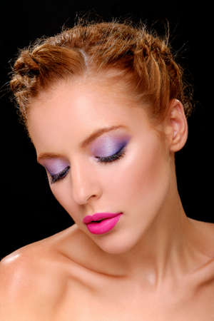 bowed head: Beautiful girl with bright fashion makeup. Closed her eyes. Bowed her head.