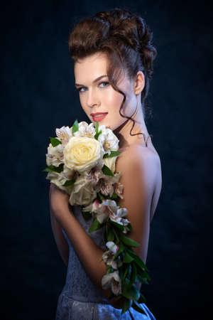 Gorgeous Brunette bride with wedding bouquet. Instagram toned. photo