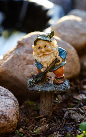 lawn gnome: Garden gnome with a shovel.