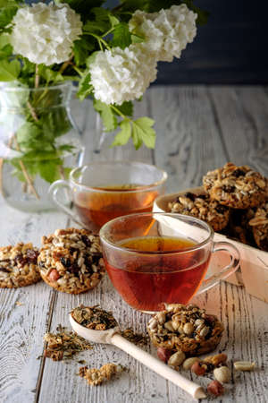 Cup of tea and cookies made of nuts and raisins. Kozinaki. photo
