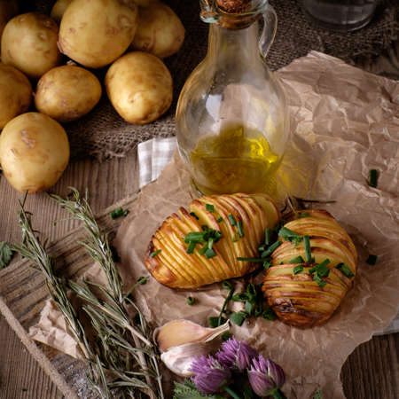 jacket potato: Sliced baked potatoes over wooden background. Rustic style.